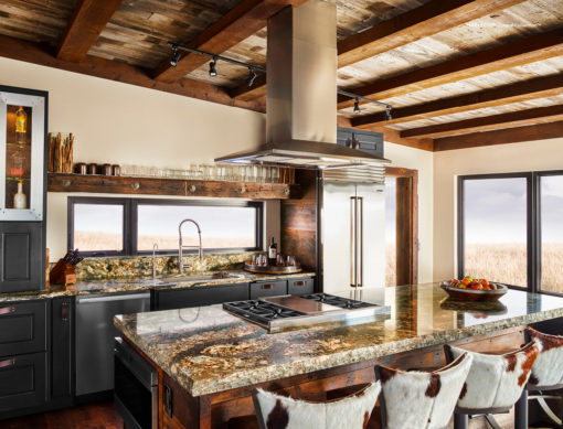 Harlech Cambria Quartz Kitchen Countertops with Brown Wood Cabinets, Stainless Steel, and Bar Stools