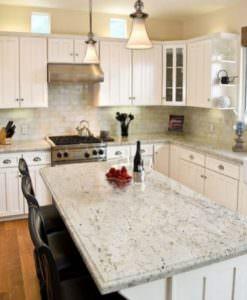 Incredible White Granite Island with Apron Farmhouse Sink