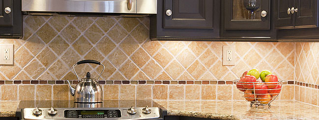 Tile Backsplash Installation Along the Kitchen Stove Area