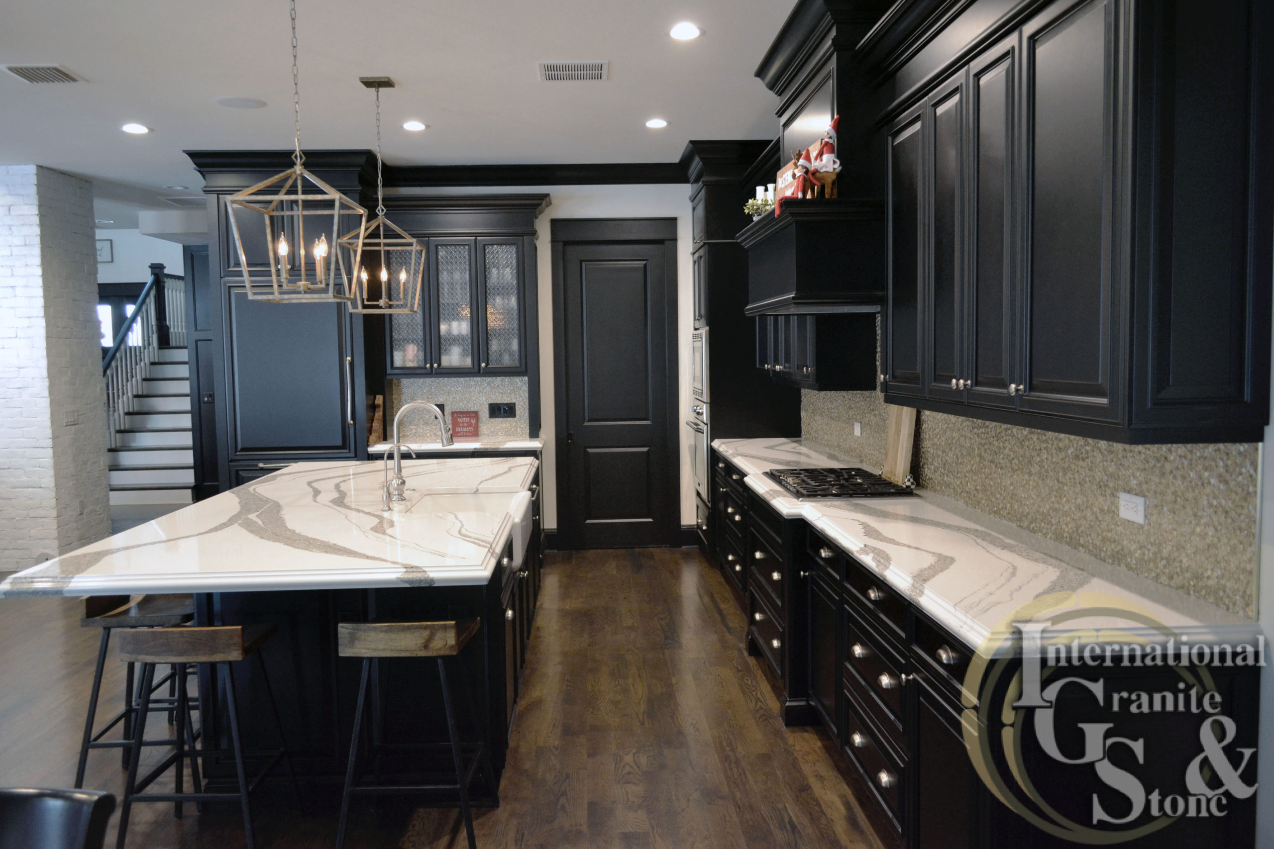 Dark Cabinet Kitchen with Cambria Quartz Striking Veining and White Background