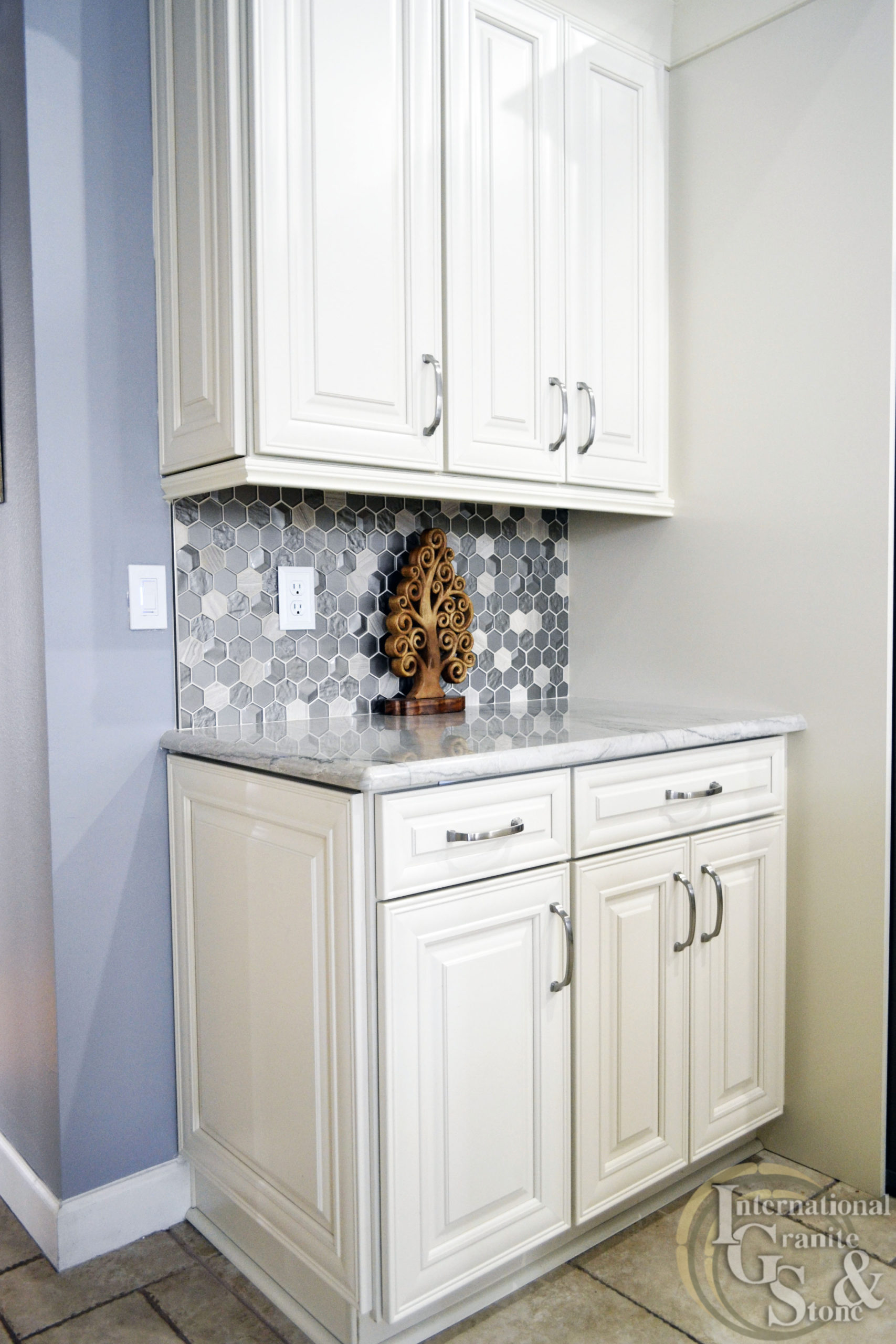 Quartzite Countertops with White Cabinets and Tile Backsplash