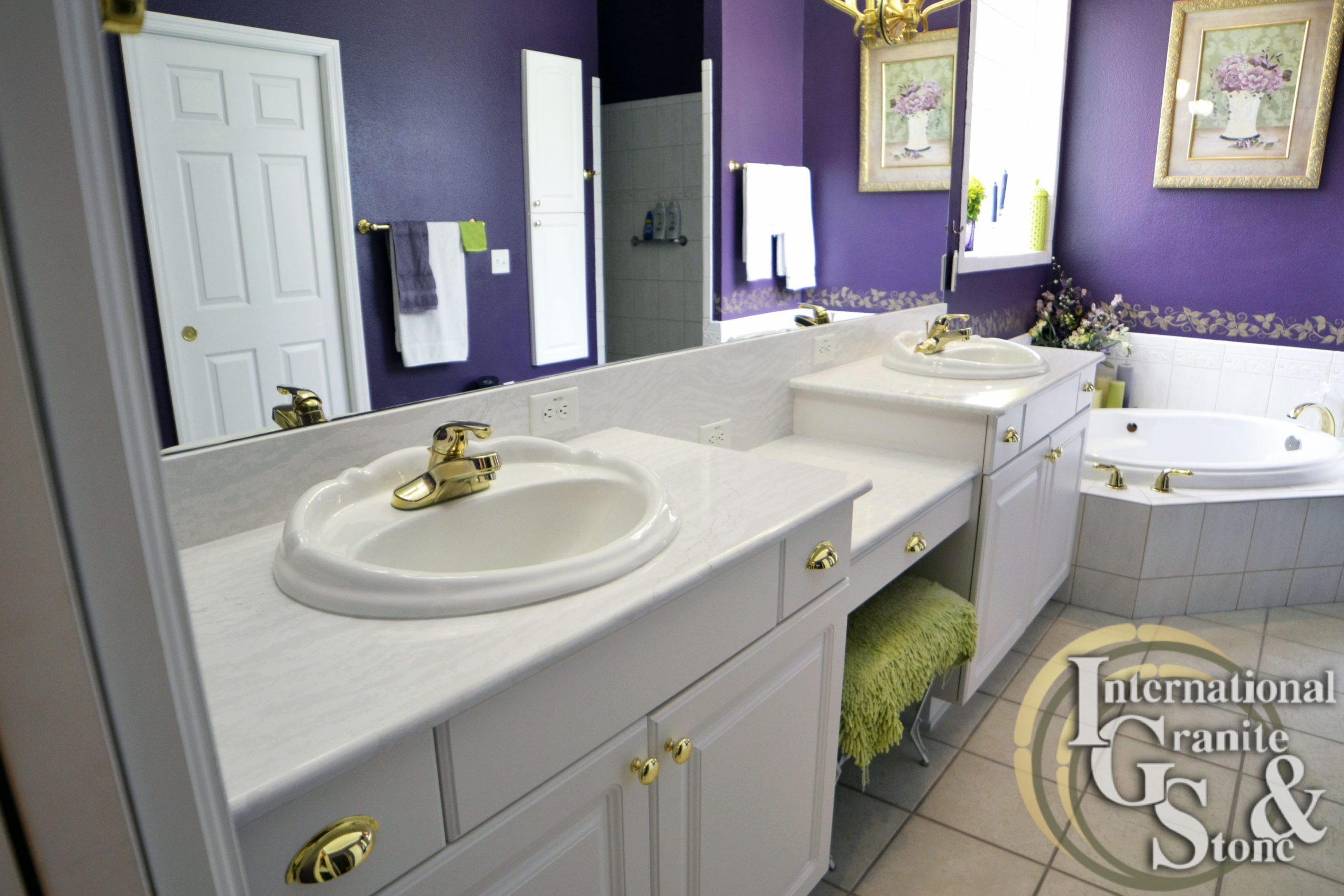 Double Sink Cambria Delgatie Countertops in Bathroom with White Cabinets