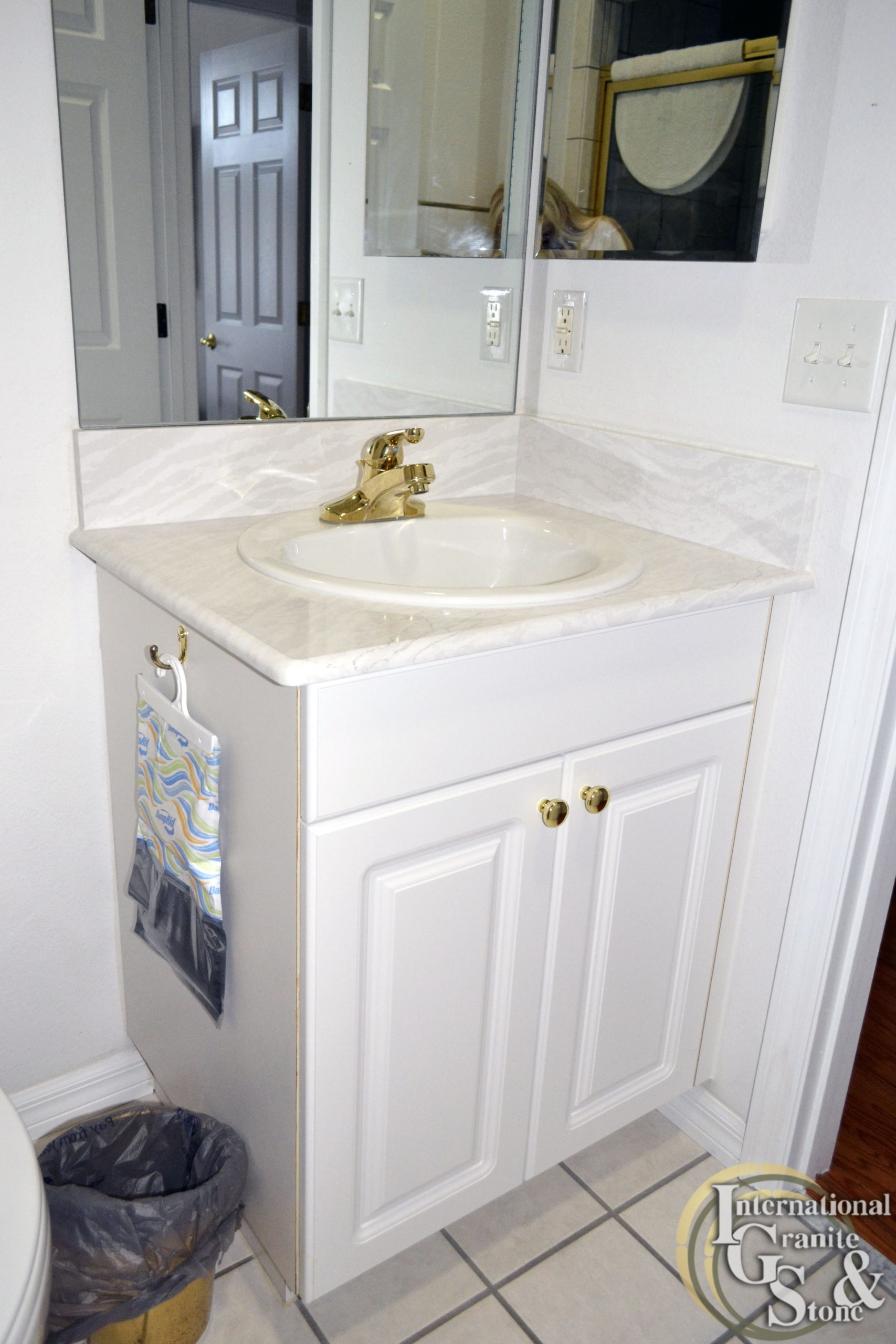 Small Bathroom Vanity from Cambria Remnant with White Cabinets and Mirror