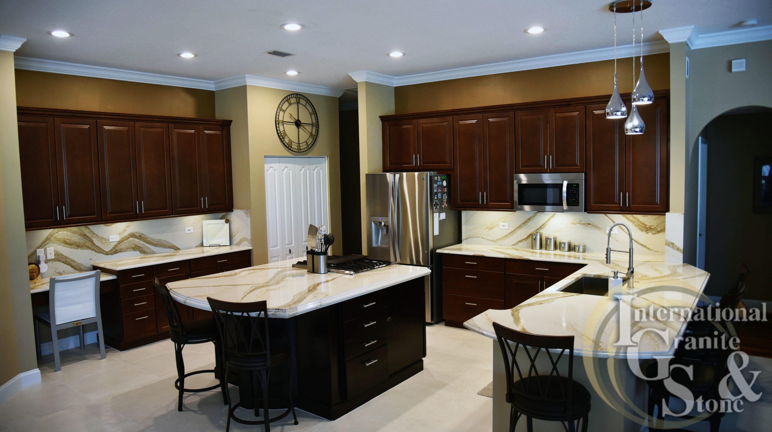 Brittanicca Gold Cambria Quartz Countertops in Kitchen with Backsplash and Dark Wood Cabinets in Fitzgerald Home Remodel