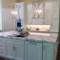 Statuarietto Selected Marble Countertops with Painted Blue Teal Cabinets Installed Tampa Florida