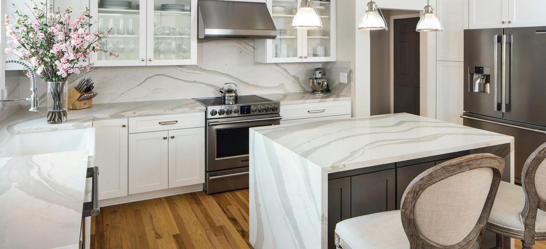 Cambria Quartz Brittanicca Warm Kitchen with Full Height Quartz Backsplash and a Waterfall Panel Island