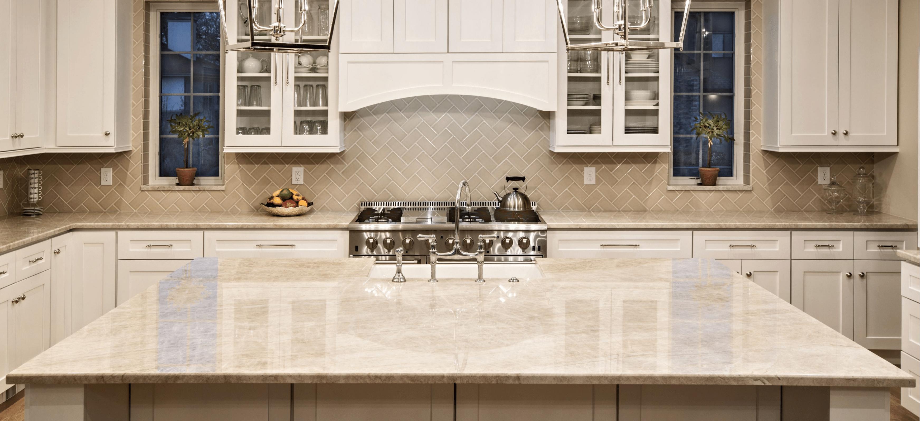 Taj Mahal Quartzite Kitchen Countertops and Island with Cream Subway Tile Backsplash Natural Stone Countertops