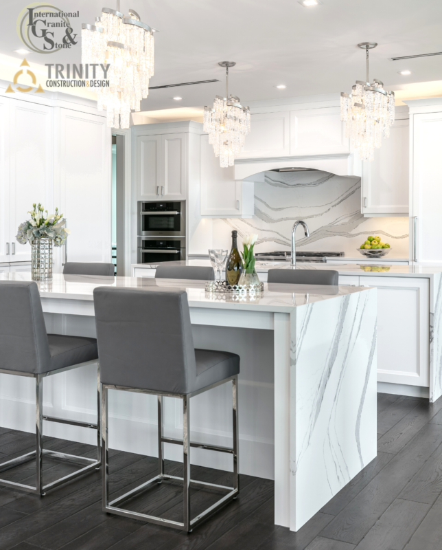 Cambria Brittanicca Kitchen Countertops White and Gray Quartz Countertops White Cabinets Kitchen Island marble looking quartz International Granite and Stone Trinity Construction and Design Collaboration gray furniture gray flooring white tile backsplash