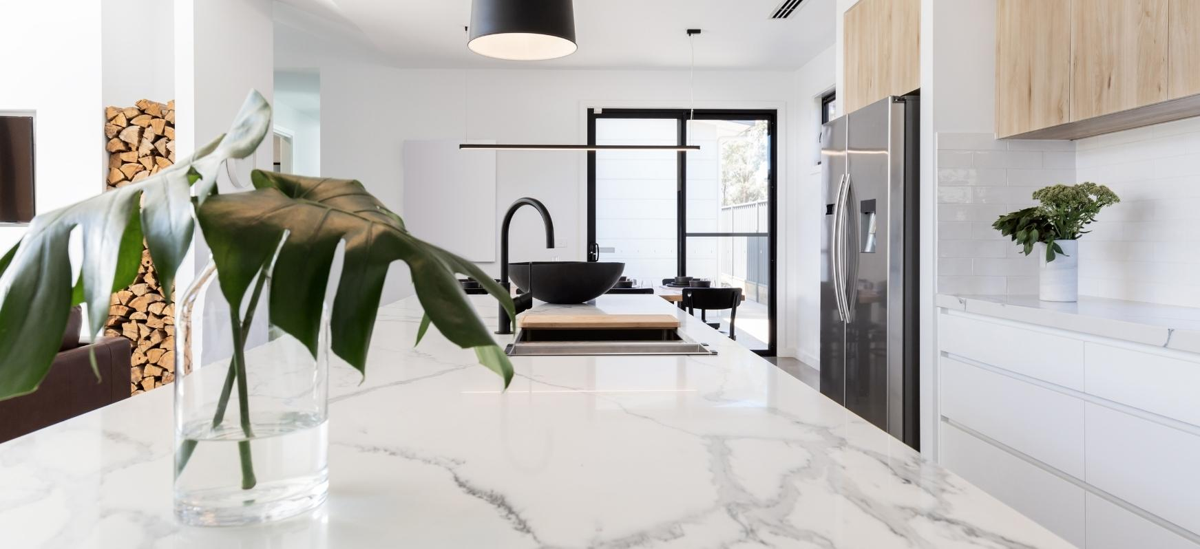 White Marble Kitchen Countertops with Marble Island and Matte Black Stainless Steel Faucet Natural Stone Countertops