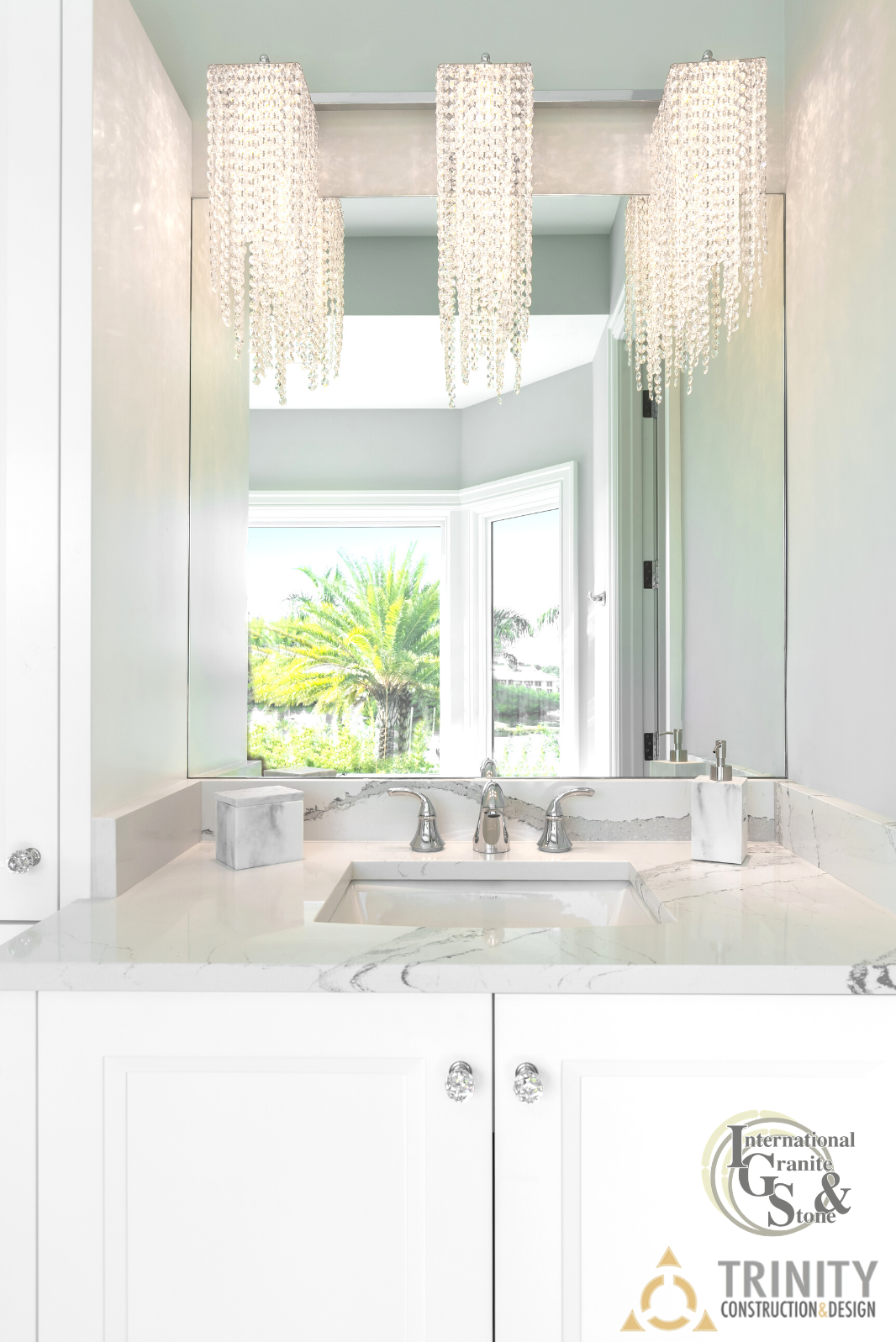 Cambria Quartz Bathroom Vanity with White Cabinets and Luxury Lighting