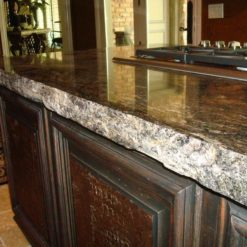 Chiseled Edge on Granite Countertop with Dark Brown Wood Cabinets