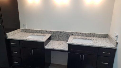 Ornamentale White Granite Bathroom
